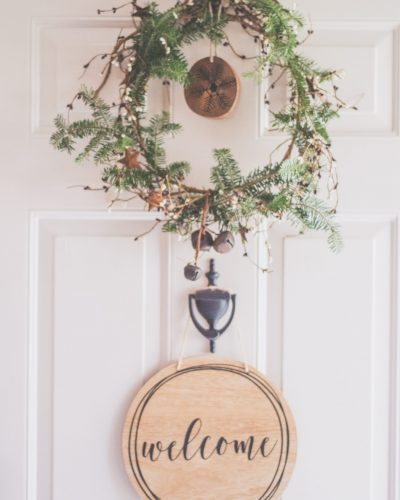 Canva - Photo of a White Door With a Hanging Wreath and Welcome Decor (2)