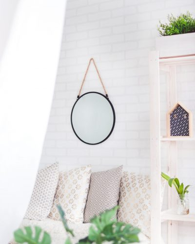 Canva - Round Black Framed Mirror on the Wall (2)